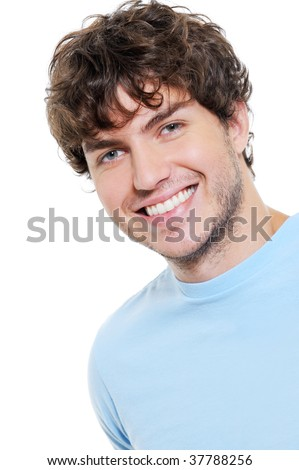 Portrait of happy cheerful handsome guy with brown curly hair - stock photo