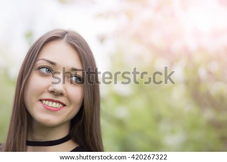 Portrait of happy cheerful smiling young beautiful woman outdoors, with copyspace