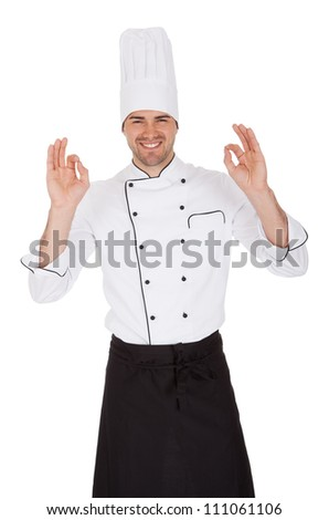 Portrait of happy chef. Isolated on white