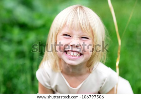 Portrait of happy child girl with grinning smile - stock photo