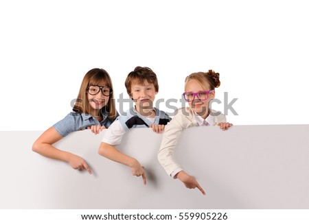 Portrait of happy children with white blank isolated on white background
