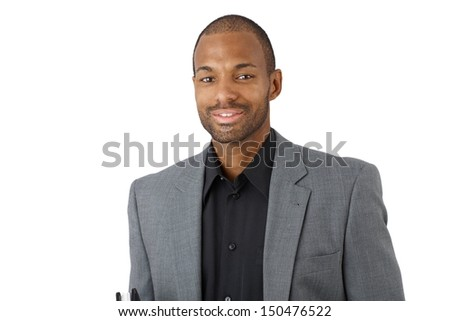 Portrait of happy confident black businessman in suit, smiling at camera.