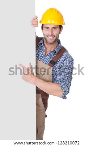 Portrait of happy construction worker presenting empty banner. Isolated on white - stock photo