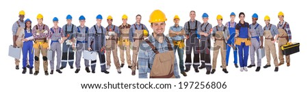 Portrait of happy construction worker with colleagues standing over white background - stock photo