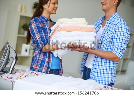 Portrait of happy couple during housework - stock photo