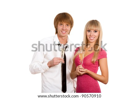 Portrait of happy couple in with glass of champagne toast, looking at camera and smiling, isolated over white background - stock photo