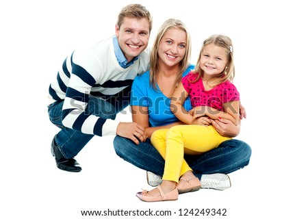 Portrait of happy couple smiling with cute daughter isolated against white background