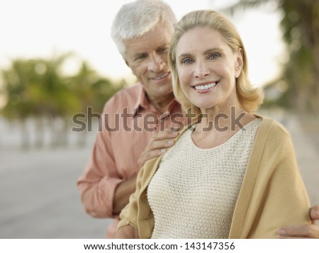 Portrait of happy couple spending time on tropical beach - stock photo