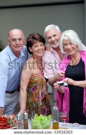 Portrait of happy couples of seniors - stock photo