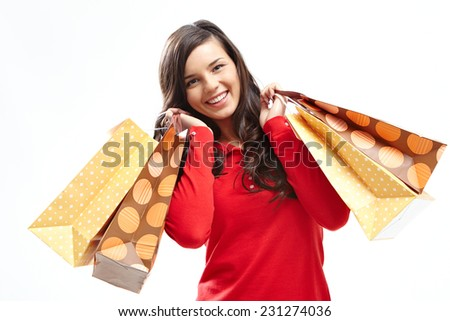 Portrait of happy customer with shopping bags looking at camera in isolation - stock photo