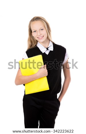 Portrait of happy cute beautiful blond schoolgirl wearing black formal outfit with bow tie, holding yellow folder, posing, friendly smiling, isolated studio shot, white background - stock photo