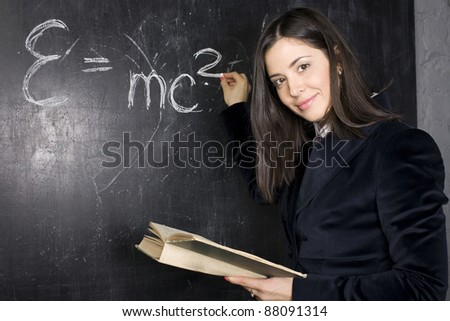portrait of happy cute student at blackboard