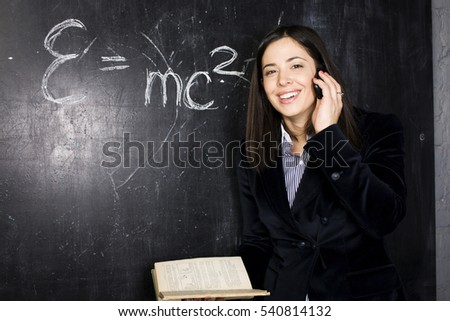 portrait of happy cute student in classroom at blackboard back