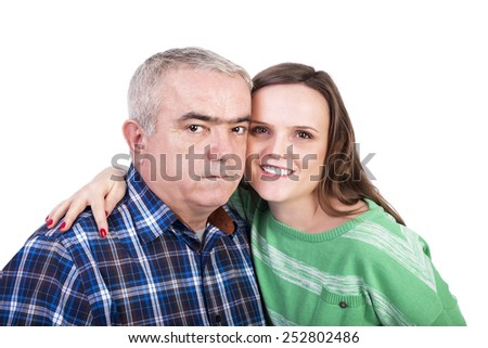 Portrait of happy daughter and father against white background - stock photo