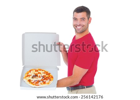 Portrait of happy delivery man showing fresh pizza on white background - stock photo