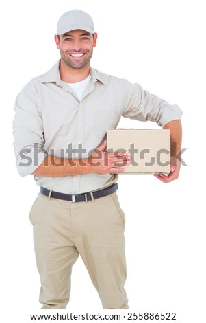 Portrait of happy delivery man with cardboard box on white background - stock photo
