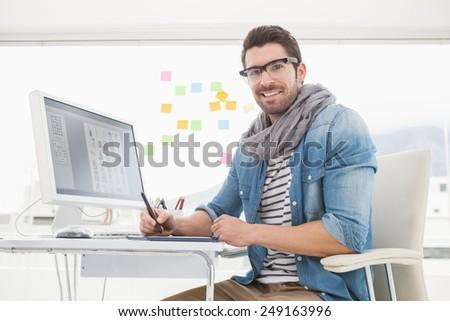 Portrait of happy designer using digitizer in the office - stock photo
