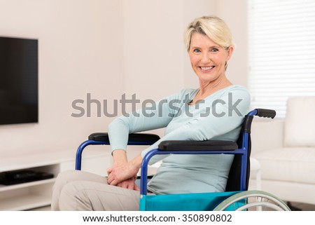portrait of happy disabled senior woman sitting at home - stock photo