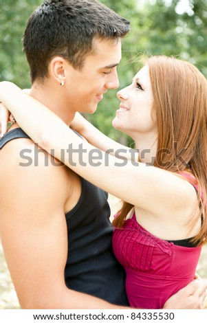 portrait of happy embracing couple in park