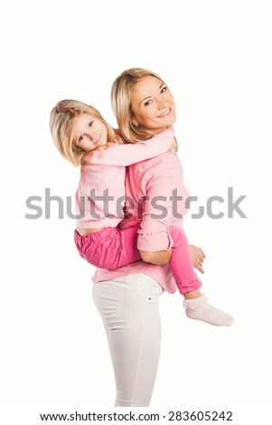 Portrait of happy embracing mother and daughter- happy family concept  - stock photo