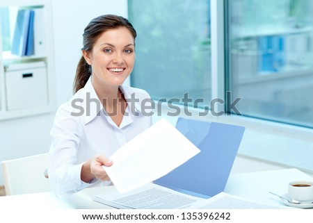 Portrait of happy employer giving test results to applicant - stock photo
