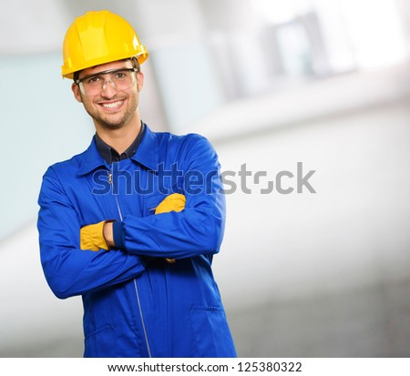 Portrait Of Happy Engineer, Indoors - stock photo