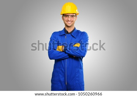 Portrait Of Happy Engineer Isolated On Grey Background