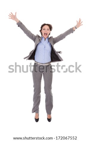 Portrait Of Happy Excited Young Businesswoman With Hand Extended - stock photo