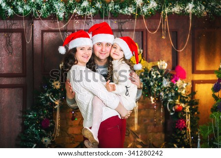 Portrait of happy family celebrating Christmas at home - stock photo