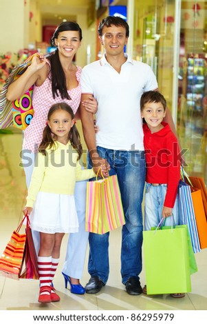 Portrait of happy family during shopping - stock photo