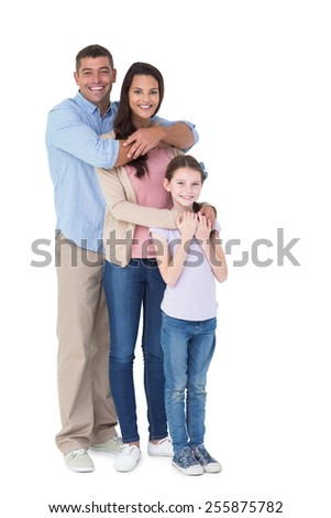 Portrait of happy family embracing each other over white background - stock photo