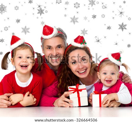 Portrait of happy family in Christmas hat on snowflakes background - stock photo