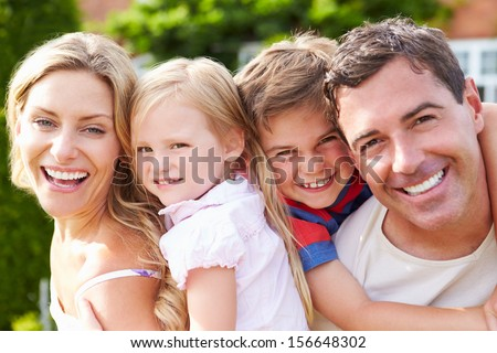 Portrait Of Happy Family In Garden - stock photo