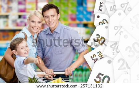Portrait of happy family in the shop. Concept of savings - stock photo