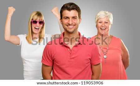 Portrait Of Happy Family On Gray Background - stock photo