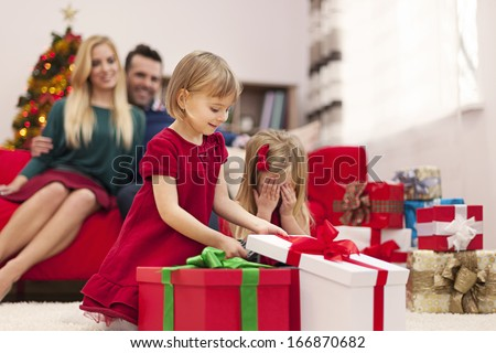 Portrait of happy family playing during the christmas time  - stock photo