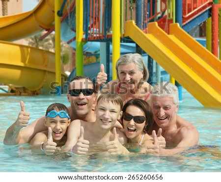 Portrait of happy family relax in the pool - stock photo