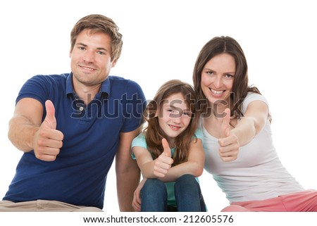 Portrait of happy family showing thumbs up together over white background - stock photo