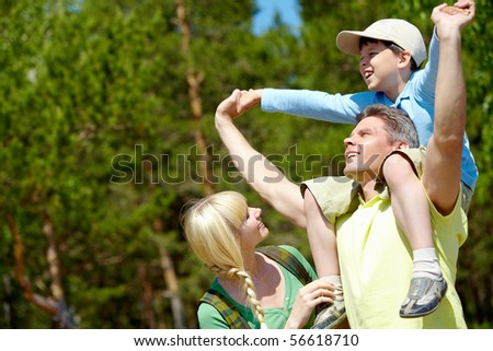 Portrait of happy family spending great time in the country - stock photo