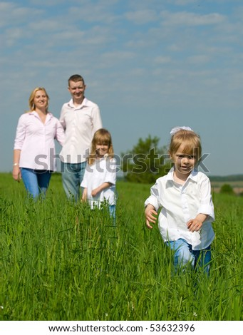 Portrait of happy family with children on rest - stock photo