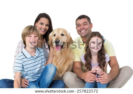 Portrait of happy family with golden retriever over white background - stock photo