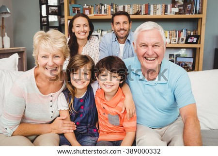Portrait of happy family with grandparents at home - stock photo