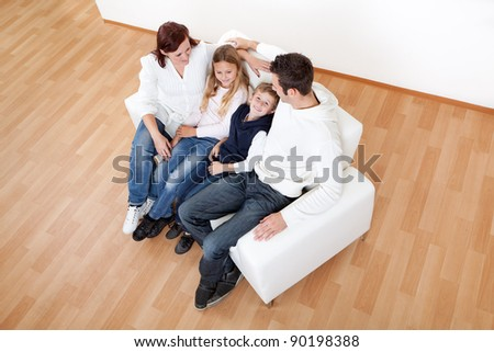 Portrait of happy family with their children at home - stock photo