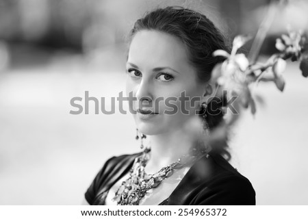 Portrait of happy fashion woman on nature  - stock photo