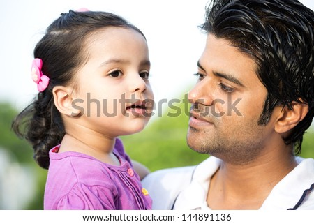 portrait of happy father and and daughter in the outdoors - stock photo