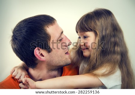 Portrait of happy father and daughter