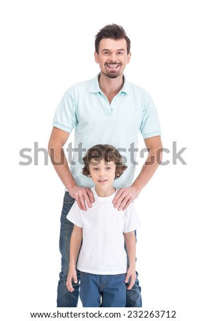 Portrait of happy father and his smiling son, on the white background. - stock photo