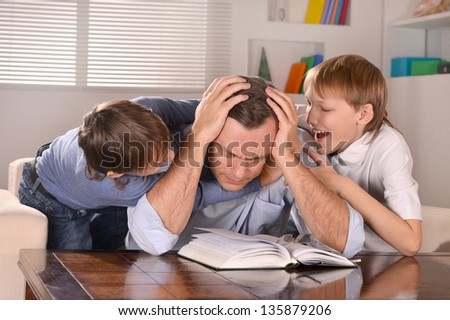 Portrait of happy  father and his two sons  at home - stock photo