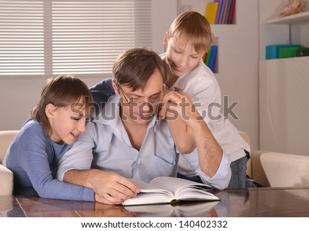 Portrait of happy  father and his two sons  at home