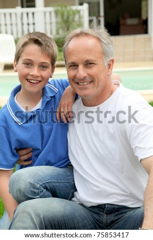 Portrait of happy father and son - stock photo